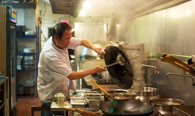 Chef Chu, with wok, cooking in a Taiwanese restaurant