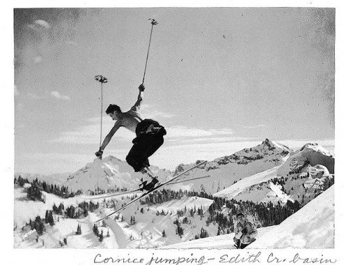 Photo of skier who is cornice jumping, black and white